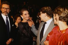 Robert Wolders, Audrey Hepburn, Yves Saint Laurent, and Loulou de la Falaise at a Givenchy Party during fashion week in Paris, France, January 1990.