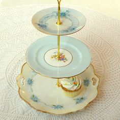 Alice in the White Room, Vintage China 3 Tier Sky Blue Cupcake Stand or Cake Plate Tray for High Tea, Centerpiece, Shower or Wedding. $155.00, via Etsy.