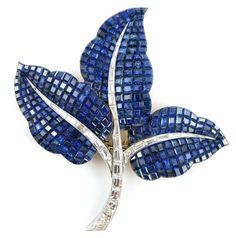 Van Cleef and Arpels, Invisibly set sapphire and diamond leaf brooch, 1960-70
