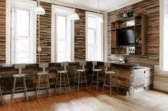 Tracey MacKenzie: InTheMo's Reclaimed Wood Bar For this project, I like the idea of a wood bar with a wood or stone bar top. Its rustic and masculine but clean and contemporary with feminine qualities.