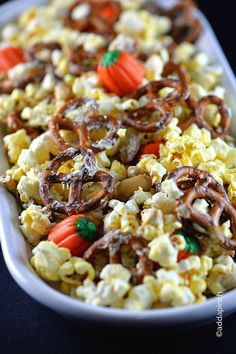 This Halloween Snack Mix Recipe is sure to a favorite for all of your festivities! Made with popcorn, pretzels and a few other goodies, it is always a hit!