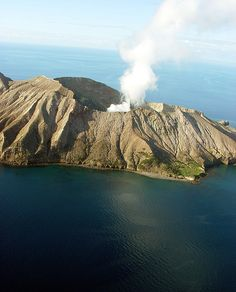 Active volcano . White Island .Bay of Plenty . NZ . . . On a clear day & if the Island is puffing hard . I can see the smoke on the horizon from my coastline .