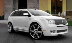 Lexani Wheels, the leader in custom luxury wheels.  White Lincoln MKX with chrome and black lx-6 with ss lip