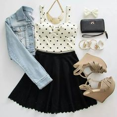 Light-wash denim jacket paired w/ a polka dot halter top, black skater skirt, gold plates statement necklace, black clutch wallet, white bow, and nude strappy wedges