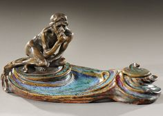 Exceptional inkstand, .Le Penseur. in blood red and green enamelled ceramic adorned with a bronze sculpture representing a pensive person. Incised signatures .Dalpayrat., .M.Dufrene and A.Charpentier. on the bronze. Circa 1903-1904.