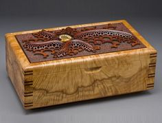 This gorgeous box is a marriage of art and beautiful wood.  remarkable work