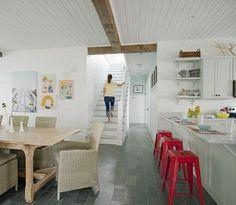 beach-inspired white kitchen with rattan furniture