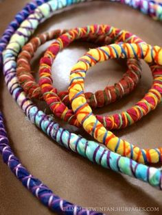 How to Make Fabric-Wrapped Cord Necklace or Bracelet. Wear them separately or all together for a fun and funky look. These fabric wrapped cord bracelets and necklaces jazz up any outfit! Fabric Beads, Paper Beads, Fabric Art, Fabric Scraps, Scrap Fabric, Chair Fabric, Fabric Bracelets, Fabric Necklace, Cord Bracelets