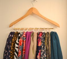 .hangers and shower curtain rings...easy scarf organization. [from Pearls and Paws]