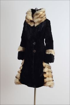 1920's coat made of soft sheared beaver fur and trimmed in Fitch fur, wide cuffed sleeves, tall wrapped collar, two button closure in front, acetate lining with interior pocket, made by Herman & Ben Marks Fur of Detroit