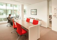 Desk and client meeting table - all in one!  BarentsKrans Law Office.