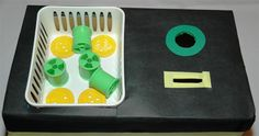 Fine motor task box. Abstract/Verbal: Strengthens fine motor skills (palmer to pincer)