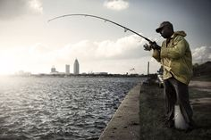 People fishing on the Causeway on Mobile Bay.