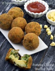 Every bite of the Potato Cheese Stuffed Balls delivers an exhilarating rush of flavour. A crispy outer layer gives way to a tasteful mix of mashed potatoes, crunchy capsicum and other flavourful ingredients, which in turn leads to a gooey cheesy centre. Indian Snacks, Indian Food Recipes, Vegetarian Recipes, Snack Recipes, Cooking Recipes, Potato Snacks, Savory Snacks, Quick Snacks, Spicy Bite