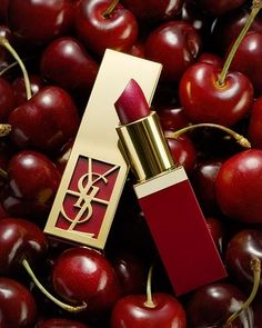 Cherry red YSL lipstick. (Purple red...makes your teeth look whiter- as opposed to orangey red)
