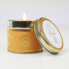 Amber Canova Candle In Tin: Bring the natural botanical fragrance of the Royal Botanic Gardens of Kew into your home with this  Amber candle. Inspired by the wealth of living plant collections at Kew; each candle creates a pure & complex aroma.