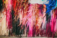 Tuesday's happy inducing find: hued streamers created by the two ladies behind The Color Condition. The streams are made from a mixture of table cloths, shower curtains, and painters drop clo… Velvet Goldmine, Streamer Wall, Confetti System, Paper Bunting, Paper Streamers, Tissue Paper, Festa Party, Luau Party, Artistic Installation