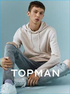 Topman goes skaterboy casual with a hoodie and ripped denim jeans for fall.
