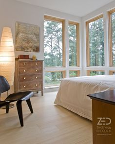 Bedroom with views, natural day lighting, bamboo floors and radiant heating. English Residence - Orleans, MA. ZeroEnergy.com