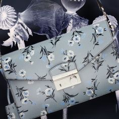 Prada Saffiano Piccolo Bag   WINTER BLOOMS: When it comes to Prada's prints, who says florals can only be worn in Spring? New pretty clutches just in. #Prada #SaffianoPiccoloBag #floral
