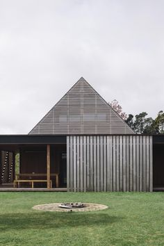 This Forest House is designed by NZ-based architects Fearon Hay. Dark wooden floors, concrete, all the wooden details and the sisal carpets makes it warm and inviting.