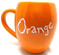 Bigfacemug-orangeback -- Would be even better if it said the opposite of the color of the mug (that is, an orange colored mug with the word blue)
