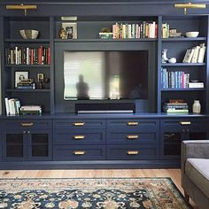 Monday blues Painting this custom designed by me in a dark colour benjaminmoore Hale Navy one of my favourite blues helps Built In Tv Cabinet, Tv Built In, Bookshelves Built In, Built In Cabinets, Bookcases, Built In Tv Wall Unit, Painted Built Ins, Tv Bookcase, Bookshelf Ideas