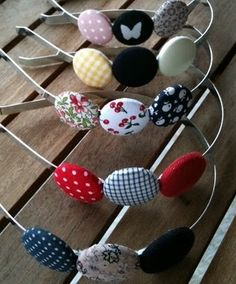 These would be so easy.  Just get three cushion buttons from the craft department and hot glue onto a head band.