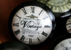 to recreate: wooden door pulls painted.  print off on thin paper script words. Lay over this clock then wording.