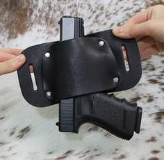 """The Bull"" model leather holster securely holds pistol in place, available at www.wearccw.com"