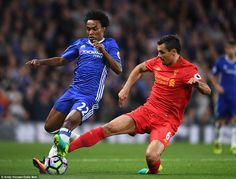 Chelsea forward Willian (left) tries to escape the attentions of Liverpool defender Lovren
