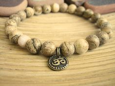 I made this Mala inspired Mens Bracelet design ( Fits up to a 7 1/4 Wrist ) from high quality semi precious 8mm Picture Jasper beads with a single