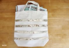In Honor Of Design: DIY Sequin Striped Tote. This would be a great way to dress up and remember my groc totes.