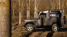Land Rover Defender 90 Td5 Sw Se-County. In the forest.