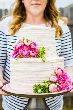 Gorgeous buttercream and chocoalte cake!  Love these ranuculus flowers!  |  mynameissnickerdoodle.com