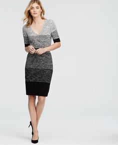 """Cast in a wintery marled mix, our curve-hugging sweater dress is gorgeously gradated for a slimming silhouette. V-neck. Short sleeves. Ribbed cuffs and hem. 35 1/2"""" from shoulder to hem."""