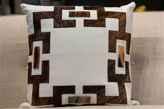 """$360          The Margot 18 Pillow by V Rugs Home will add dimension to any decor with its geometric pattern of brown hide and horn buckles that contrasts beautifully with its beige hemp background. Add an exotic flair to your bed or sofa with this exquisite throw pillow, it is sure to please! Luxe Home Philadelphia carries hundreds of modern exotic and chic pillow and throws that are calling your name, shop in store or online today!          Features  18"""" x 18""""  Oyster/Brown Hide"""