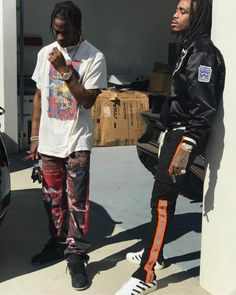 0139cd62378936 Travis Scott Rocks Supreme Jeans And KAWS X Air Jordan Sneakers With Quavo  In Fear Of God Jacket