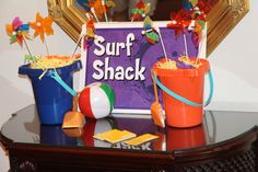 Great table decor! Use sand buckets and small beach toys to create a scene for tables! Love these ideas! cokesburyvbs.com