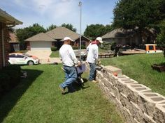GroundScape, a Fort Worth Landscape Company, is installing a retaining wall out of stone pavers.