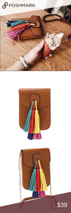 Melie Blanco Saddle Crossbody Multi Color Tassels PreOrder ❣️Melie Blanco Saddle Kai Crossbody with Multi Color Tassels. Premium Vegan Leather. Fold Over Snap Closure. Interior Zipper Pocket. Removable Leather and Gold Chain Crossbody Strap. Dimensions 5'L x 1.3'W x 7'H. Color: Saddle with Multi Color Tassels Melie Bianco Bags Crossbody Bags