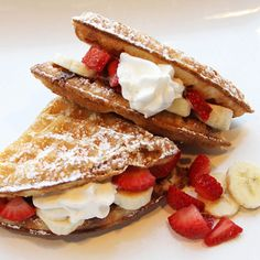 Romeo + Juliet Waffle Sandwich. stuffed with strawberries, bananas, maple syrup, Nutelle and fresh whipped cream.
