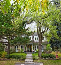 Lovely exterior with a mansard roof.  It makes the house look both cottage and regal at the same time.