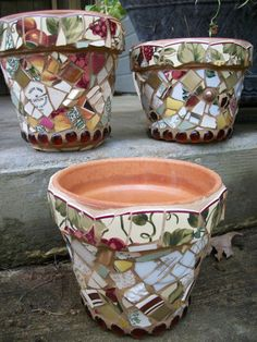 Mosaic flower pots made with bits of china.