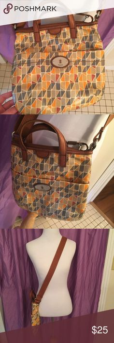Fossil Key-Per Crossbody bag Fossil Key-Per orange yellow tan and gray Crossbody bag. Mint green and white lining. Lots of pockets and in great condition. Make an offer or check out my other items for bundles! Fossil Bags Crossbody Bags