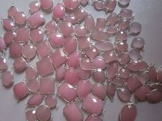 NATURAL PINK CHALCEDONY MIXED SHAPE STERLING SILVER  2LOOP CONNECTORS  100 CTS