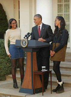 President Obama and his daughters Sasha & Malia