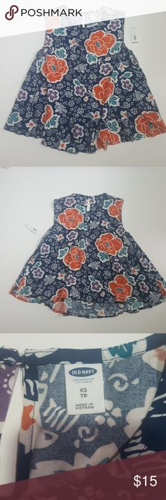 Old Navy Swing Rayon Top Dark blue, with orange and teal flowers, purple flowers and white and orange birds. This top is so cute, it would go great with white shorts or leggings. There is a button in the back at the neck line. Old Navy Tops Blouses
