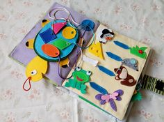 Stylish gift. Soft handmade book for baby. Perfectly develop different skills as speech, imagination and memory. Bright pages wont leave your baby unconcerned. Colorful characters will help the child to learn the colors, numbers and shapes. Simple tasks in a game form contribute to the development of logic. In addition, distract the child from modern gadgets. You will also find there pages for a free story. Pages are made with different colors and textures (knitwear, fleece, velor). All…