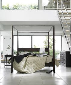 modern open loft simple black four poster bed | DelysiaStyle